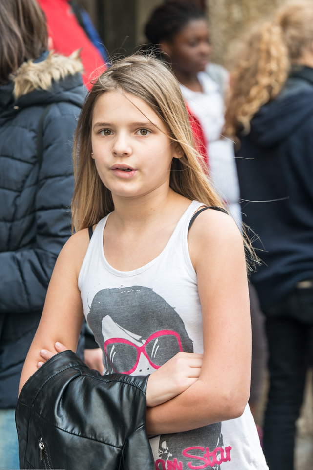 A fairly young crowd is seen in the city of Salzburg, Austria and there is a great sense of safety and comfort.