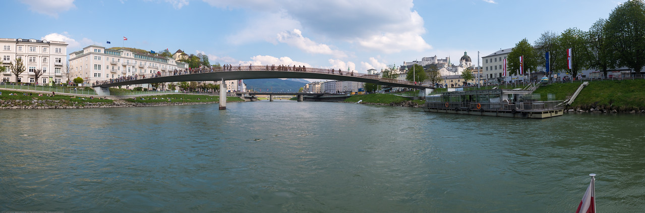 Panoramic view near Makartsteg bridge (Love Lock Bridge) over Salzach. Salzach river cruise<br /> offers an extraordinary view of the city and its scenic vistas.