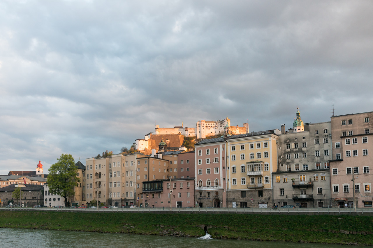 Beautiful evening light over Salzburg, with the river Salzach in the foreground.