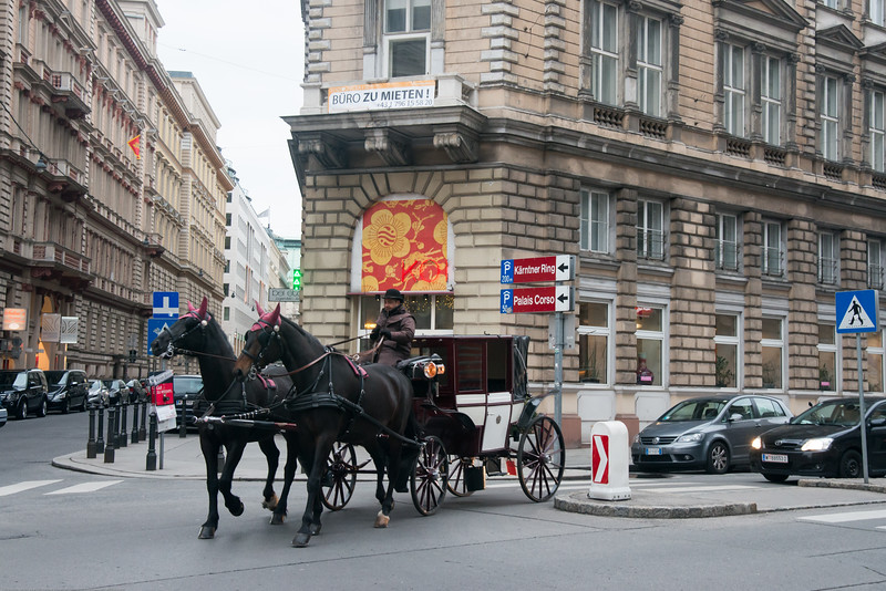 Streets of with horse carriages. Vienna, Austria.