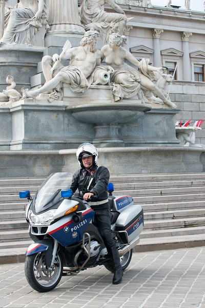 Police at the Austrian Parliament Building happy to pose for a picture in Vienna, Austria.