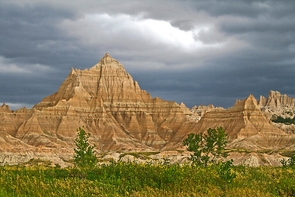 Storm clouds gather over the Wall, a 100-mile stretch of tiered cliffs in Badlands National Park in South Dakota, #0735