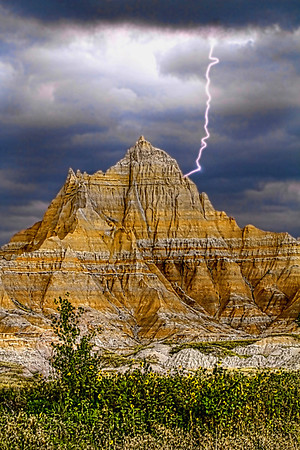 Lightening strike in summer storm at the Badlands National Park -- one of the largest protected mixed-grass prairies in the United States. This blend of long and short grasses helps sustain the abundance of wildlife that lives inside the park, #0734