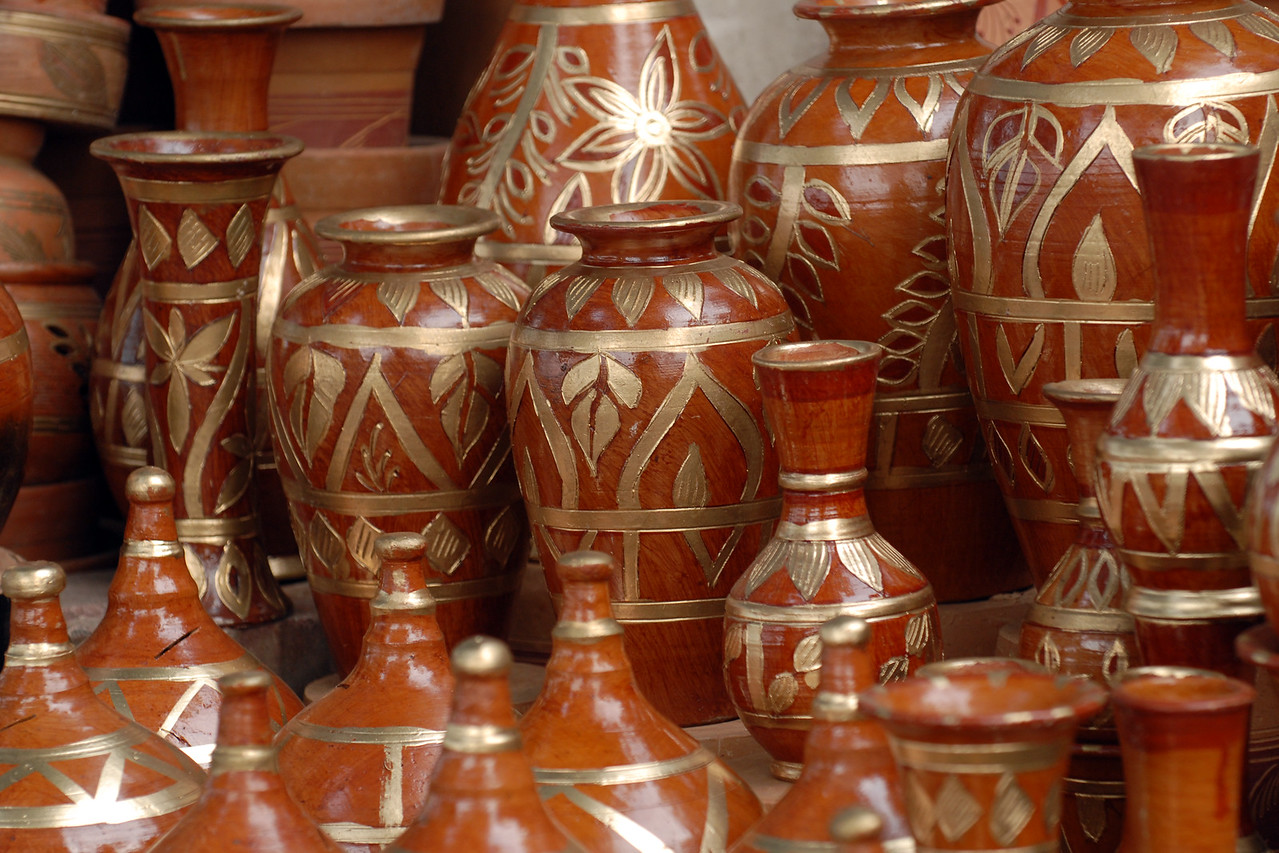 Clay pots being sold on the streets of Dhaka.<br /> <br /> Dhaka (Bangla: ঢাকা, pronounced [ɖʱaka])— (Dacca) is the capital city of Bangladesh (Bengali: বাংলাদেশ [ˈbaŋlad̪eʃ] Bangladesh). Dhaka, located on the banks of the Buriganga River is a megacity with a population of over 12 million. Dhaka is known as the City of Mosques and renowned for producing the world's finest muslin. it is a center for culture, education and business.