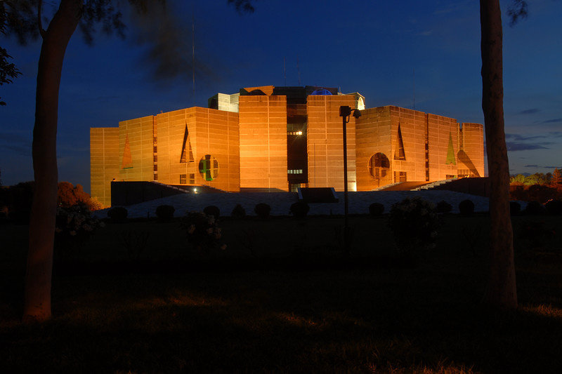 Night view of Jatiyo Sangsad Bhaban (Bengali: জাতীয় সংসদ ভবন Jatio Shôngshod Bhôbon) This  National Assembly Building of Bangladesh is located in the capital Dhaka and was created by architect Louis I. Kahn. It houses all parliamentary activities of Bangladesh.<br /> Dhaka (Bangla: ঢাকা, pronounced [ɖʱaka])— (Dacca) is the capital city of Bangladesh (Bengali: বাংলাদেশ [ˈbaŋlad̪eʃ] Bangladesh). Dhaka, located on the banks of the Buriganga River is a megacity with a population of over 12 million. Dhaka is known as the City of Mosques and renowned for producing the world's finest muslin. it is a center for culture, education and business.