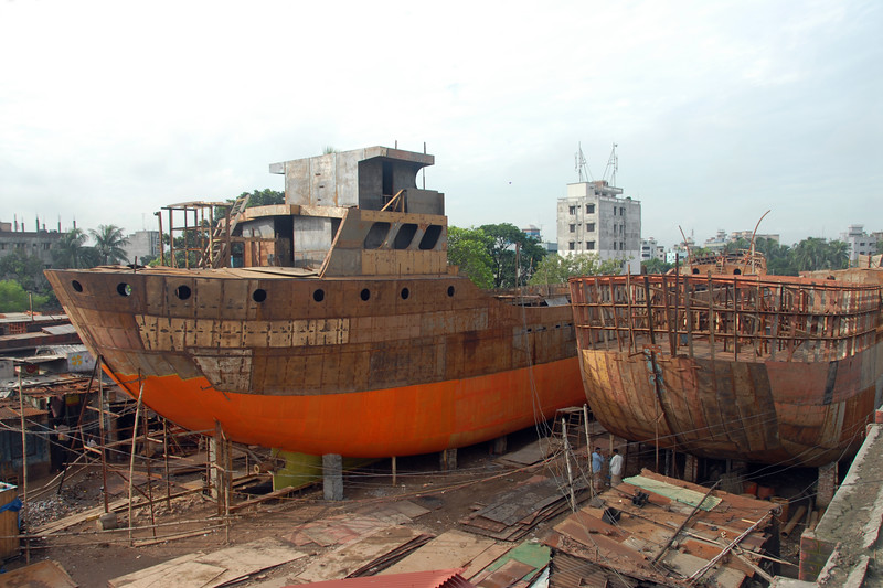 "Ship repairs in progress. Dhaka, Bangaladesh<br /> <br /> Buriganga River (Bangla: বুড়িগঙ্গা Buŗigônga ""Old Ganges""). Buriganga is the life line and much happens in and around this river. It is the main river flowing beside Dhaka, capital cityof Bangladesh. With an average depth of 39 feet (12 m) its quite amazing to see the activities along the river. Unfortunately, the river is Dhaka's main outlet of sewage waste and is threatened by pollution and waste."