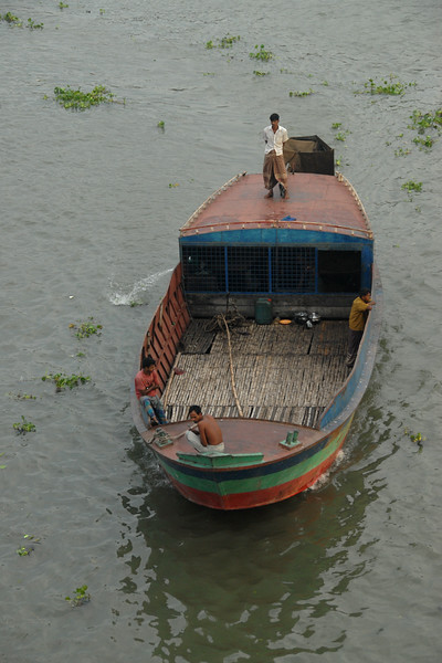 """Large launches waiting at Sadarghat on the Buriganga for different destinations in Bangladesh and ply on Buriganga River (Bangla: বুড়িগঙ্গা Buŗigônga """"Old Ganges""""). Buriganga is the life line and much happens in and around this river. It is the main river flowing beside Dhaka, capital cityof Bangladesh. With an average depth of 39 feet (12 m) its quite amazing to see the activities along the river. Unfortunately, the river is Dhaka's main outlet of sewage waste and is threatened by pollution and waste. Dhaka, Bangaladesh"""