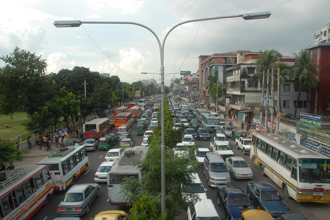 Busy and crowded streets of Dhaka.<br /> Dhaka (Bangla: ঢাকা, pronounced [ɖʱaka])— (Dacca) is the capital city of Bangladesh (Bengali: বাংলাদেশ [ˈbaŋlad̪eʃ] Bangladesh). Dhaka, located on the banks of the Buriganga River is a megacity with a population of over 12 million. Known as the City of Mosques and renowned for producing the world's finest muslin, it is a center for culture, education and business.
