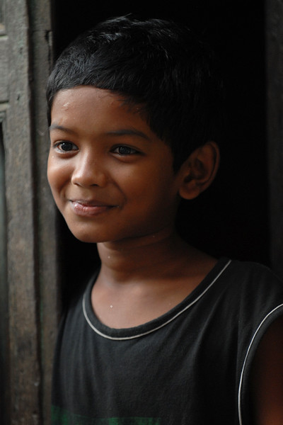 Street shots of children in Dhaka city.<br /> Dhaka (Bangla: ঢাকা, pronounced [ɖʱaka])— (Dacca) is the capital city of Bangladesh (Bengali: বাংলাদেশ [ˈbaŋlad̪eʃ] Bangladesh). Dhaka, located on the banks of the Buriganga River is a megacity with a population of over 12 million. Dhaka is known as the City of Mosques and renowned for producing the world's finest muslin. it is a center for culture, education and business.