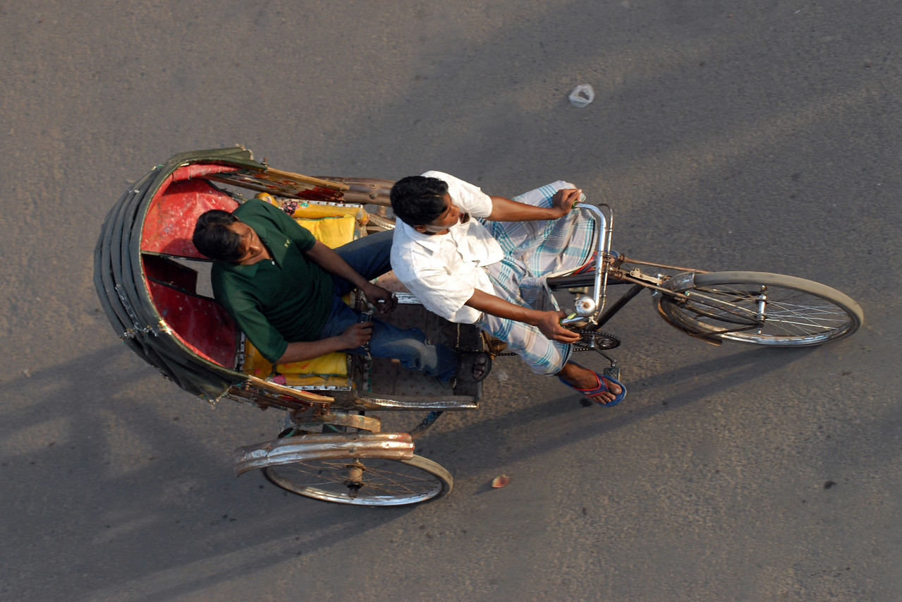 Cyclerickshaws on the streets.<br /> Dhaka (Bangla: ঢাকা, pronounced [ɖʱaka])— (Dacca) is the capital city of Bangladesh (Bengali: বাংলাদেশ [ˈbaŋlad̪eʃ] Bangladesh). Dhaka, located on the banks of the Buriganga River is a megacity with a population of over 12 million. Dhaka is known as the City of Mosques and renowned for producing the world's finest muslin. it is a center for culture, education and business.
