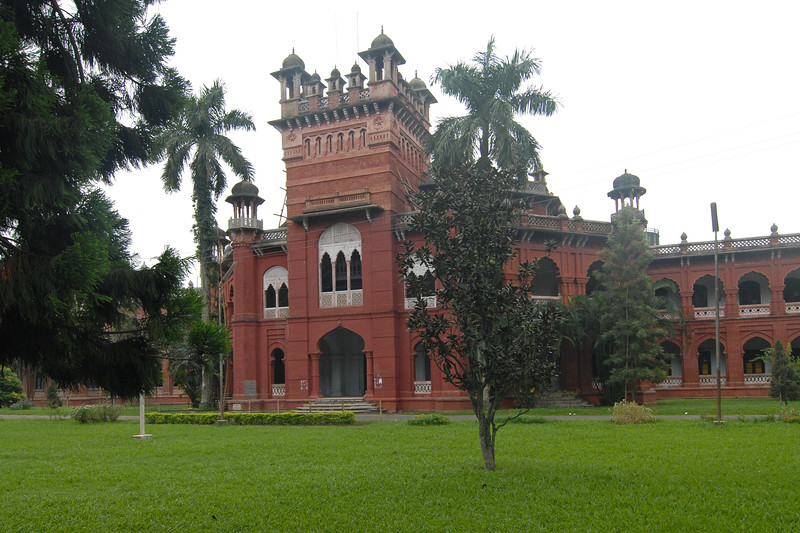 Green landscaped gardens of Curzon Hall, Dhaka.<br /> Curzon hall. Named after Lord Curzon and established in 1921.<br /> Today it is the Faculty of Science, Dhaka University, Bangladesh<br /> <br /> The red brick built building was made by the earstwhile British Raj as the Parliament for British Bengal Province in 1905. Later, it was handed over to the Oxford of the East- University of Dhaka. The hall is now used as exam hall for the Faculty of Science. while the rest of the building holds different departments. Being in the heart of one of the biggest University campuses in the South Asia and with its beautiful architechture and landscaping, it attracts many to visit.<br /> <br /> Dhaka (Bangla: ঢাকা, pronounced [ɖʱaka])— (Dacca) is the capital city of Bangladesh (Bengali: বাংলাদেশ [ˈbaŋlad̪eʃ] Bangladesh). Dhaka, located on the banks of the Buriganga River is a megacity with a population of over 12 million. Dhaka is known as the City of Mosques and renowned for producing the world's finest muslin. it is a center for culture, education and business.