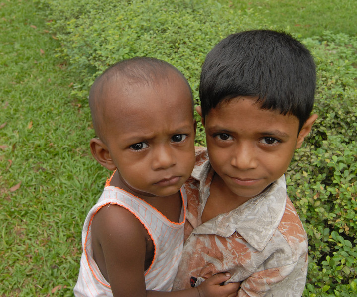 Young children near Curzon Hall, Dhaka.<br /> Dhaka (Bangla: ঢাকা, pronounced [ɖʱaka])— (Dacca) is the capital city of Bangladesh (Bengali: বাংলাদেশ [ˈbaŋlad̪eʃ] Bangladesh). Dhaka, located on the banks of the Buriganga River is a megacity with a population of over 12 million. Dhaka is known as the City of Mosques and renowned for producing the world's finest muslin. it is a center for culture, education and business.