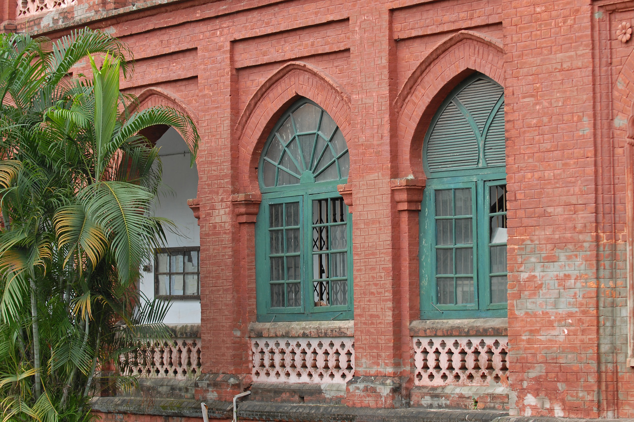Amazing architecture and beautiful facade of Curzon Hall, Dhaka. <br /> <br /> Curzon hall. Named after Lord Curzon and established in 1921.<br /> Today it is the Faculty of Science, Dhaka University, Bangladesh<br /> <br /> The red brick built building was made by the earstwhile British Raj as the Parliament for British Bengal Province in 1905. Later, it was handed over to the Oxford of the East- University of Dhaka. The hall is now used as exam hall for the Faculty of Science. while the rest of the building holds different departments. Being in the heart of one of the biggest University campuses in the South Asia and with its beautiful architechture and landscaping, it attracts many to visit.<br /> <br /> Dhaka (Bangla: ঢাকা, pronounced [ɖʱaka])— (Dacca) is the capital city of Bangladesh (Bengali: বাংলাদেশ [ˈbaŋlad̪eʃ] Bangladesh). Dhaka, located on the banks of the Buriganga River is a megacity with a population of over 12 million. Dhaka is known as the City of Mosques and renowned for producing the world's finest muslin. it is a center for culture, education and business.