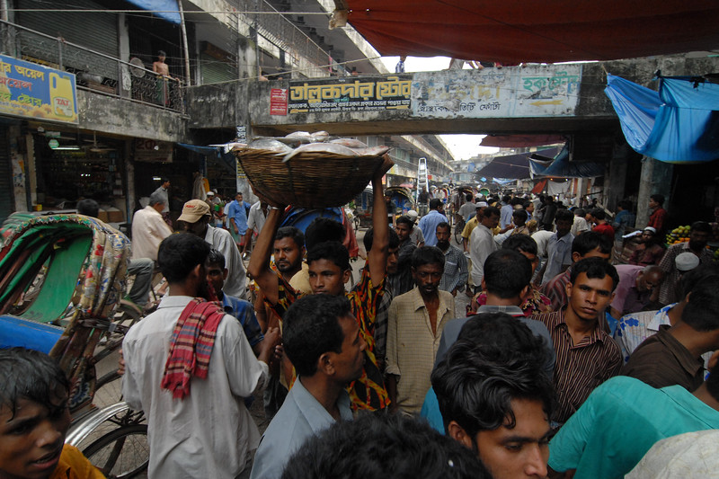 Fish market<br /> Dhaka (Bangla: ঢাকা, pronounced [ɖʱaka])— (Dacca) is the capital city of Bangladesh (Bengali: বাংলাদেশ [ˈbaŋlad̪eʃ] Bangladesh). Dhaka, located on the banks of the Buriganga River is a megacity with a population of over 12 million. Dhaka is known as the City of Mosques and renowned for producing the world's finest muslin. it is a center for culture, education and business.