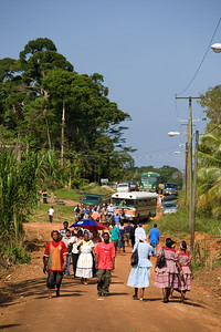 People coming by the bus loads for the funeral of local musician Andy Palacio, in Barranco Village, Toledo, Belize.