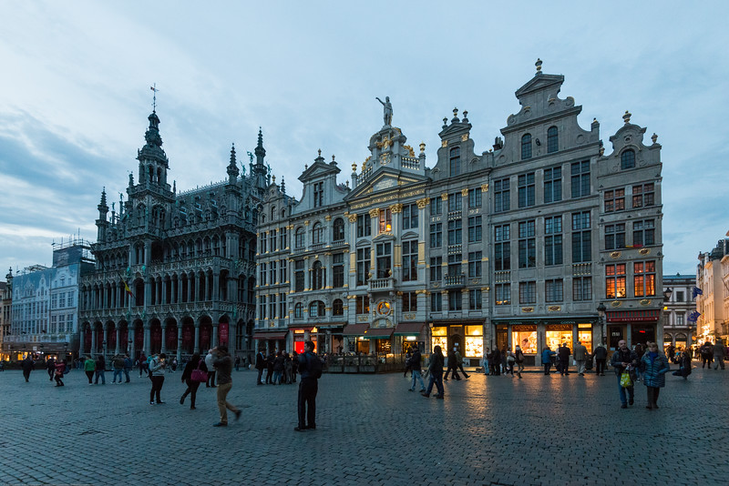 Evening view at Grand Place, Bruxelles, Belgium. Huge city square completely encircled by elegant historic buildings dating back to the 14th century.