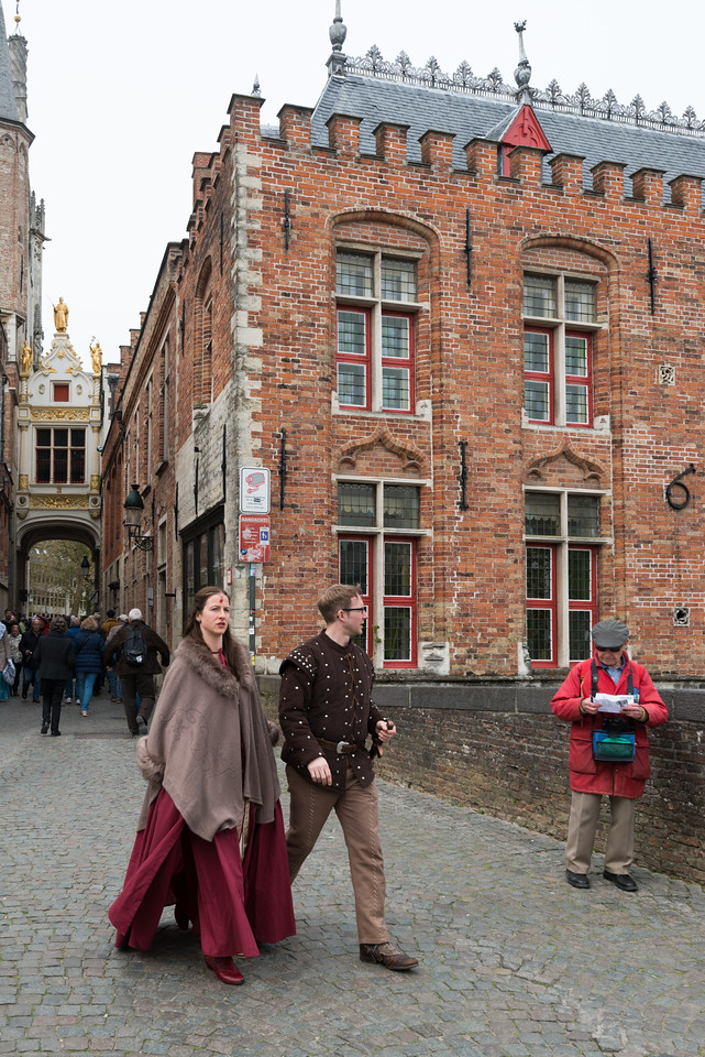 Folks dressed in traditional dress in Brugge, Belgium. Bruges is the capital and largest city of the province of West Flanders in the Flemish Region of Belgium, in the northwest of the country. It is sometimes referred to as The Venice of the North.