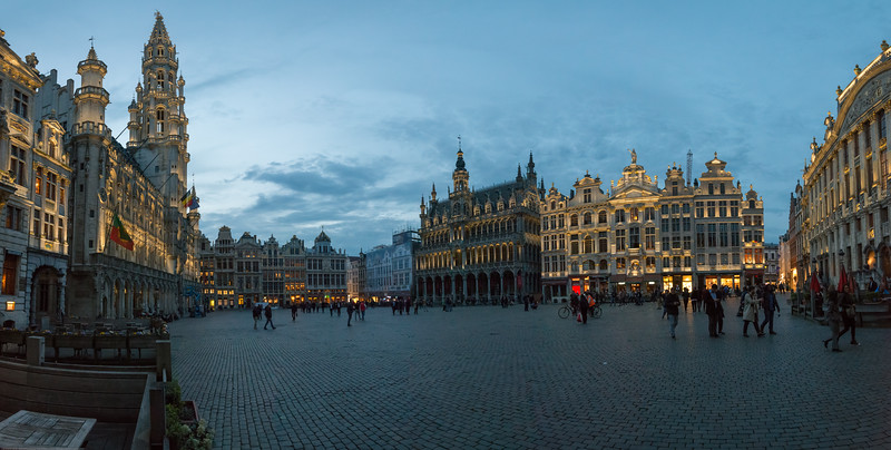 Panoramic evening view at Grand Place, Bruxelles, Belgium. Huge city square completely encircled by elegant historic buildings dating back to the 14th century.