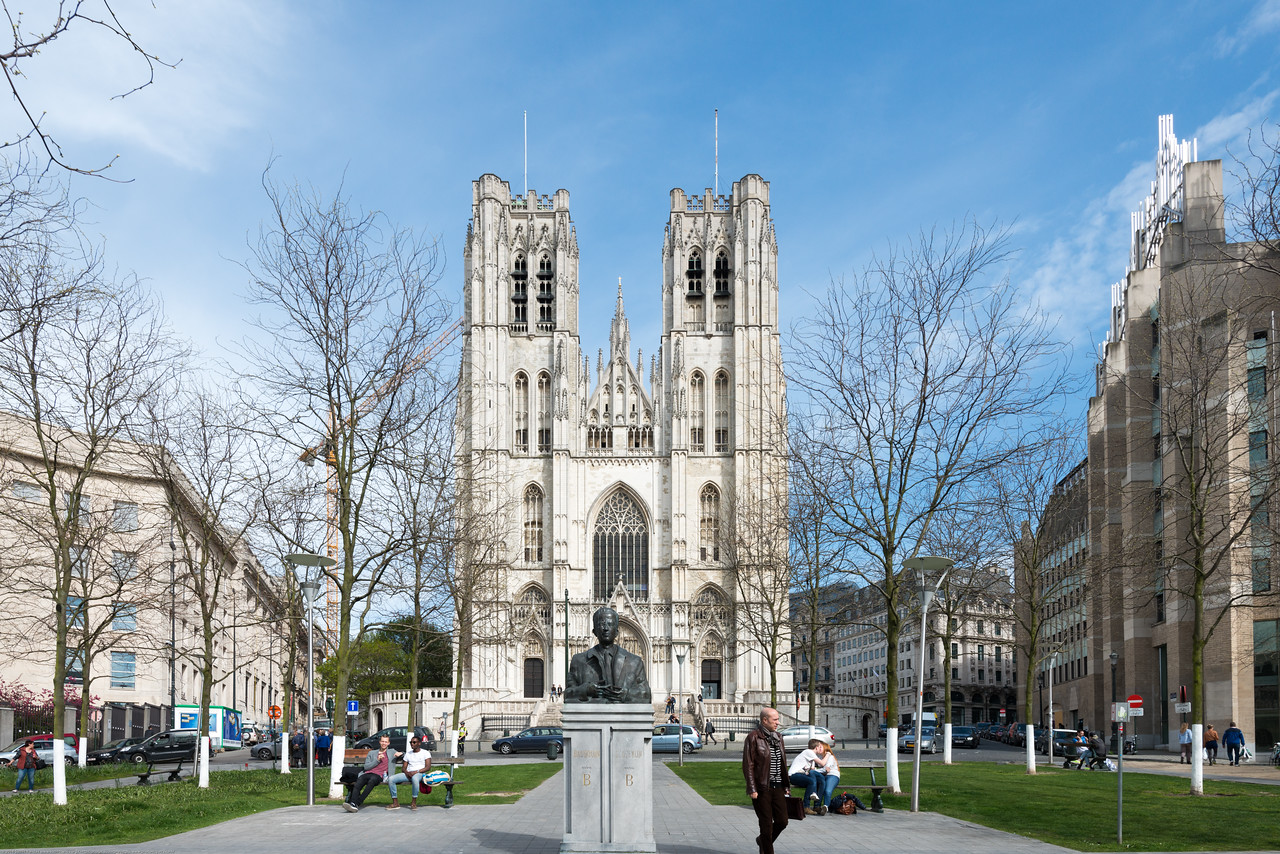 St Michael and St Gudula Cathedral, Brussels, Place Sainte-Gudule, Brussels, Belgium. People relax in the park in front.