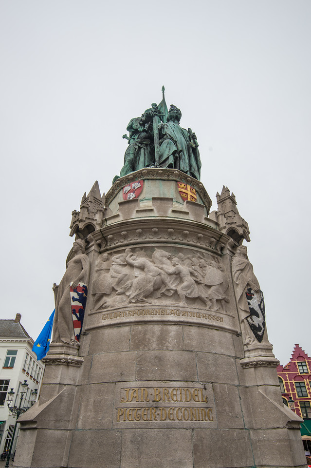 In the center of the market stands the statue of Jan Breydel and Pieter de Coninck, Place De Bruges. The Markt of Bruges is located in the heart of the city and covers an area of about 1 hectare. Some historical highlights around the square include the 12th-century belfry and the Provincial Court.