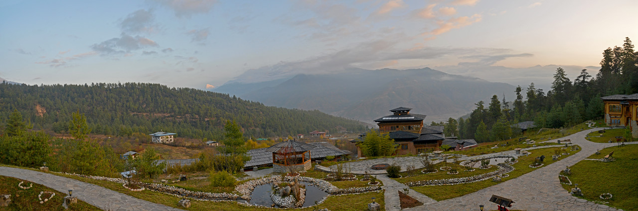 Panoramic view of Naksel Boutique Hotel & Spa and Paro, Bhutan. <br /> <br /> Blending the heritage of traditional Bhutanese architecture and the comfort of modern amenities. Main construction materials for Naksel are indigenous and locally purchased. Traditional windows, mud-bricks, framework and even furniture were locally crafted here in Ngoba Village, connecting Naksel to the surrounding forest.