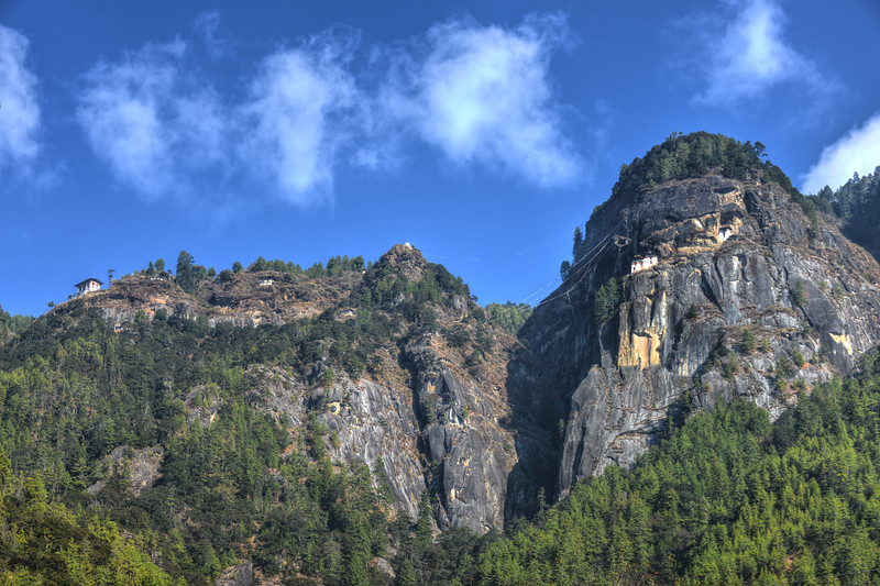 At the base of Taktsang Monastery (also called Tiger's Nest) in Paro, Bhutan. Paro Taktsang  is the popular name of Taktsang Palphug Monastery which is a prominent Himalayan Buddhist sacred site and temple complex, located in the cliffside of the upper Paro valley, A temple complex was first built in 1692, around the Taktsang Senge Samdup cave where Guru Padmasambhava is said to have meditated.