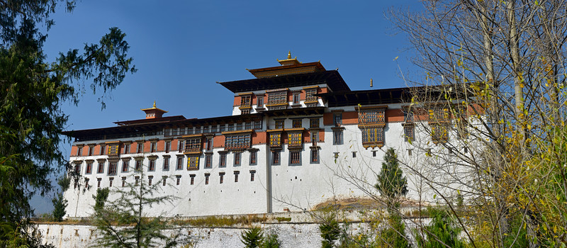 Panoramic image of Rinpung Dzong (Paro Dzong) a fortress-monastery overlooking the Paro valley which was first built on by Padma Sambhava at the beginning of the tenth century.<br /> <br /> Rinpung Dzong is a large dzong - Buddhist monastery and fortress - of the Drukpa Lineage of the Kagyu school in Paro District in Bhutan. It houses the district Monastic Body and government administrative offices of Paro Dzongkhag.