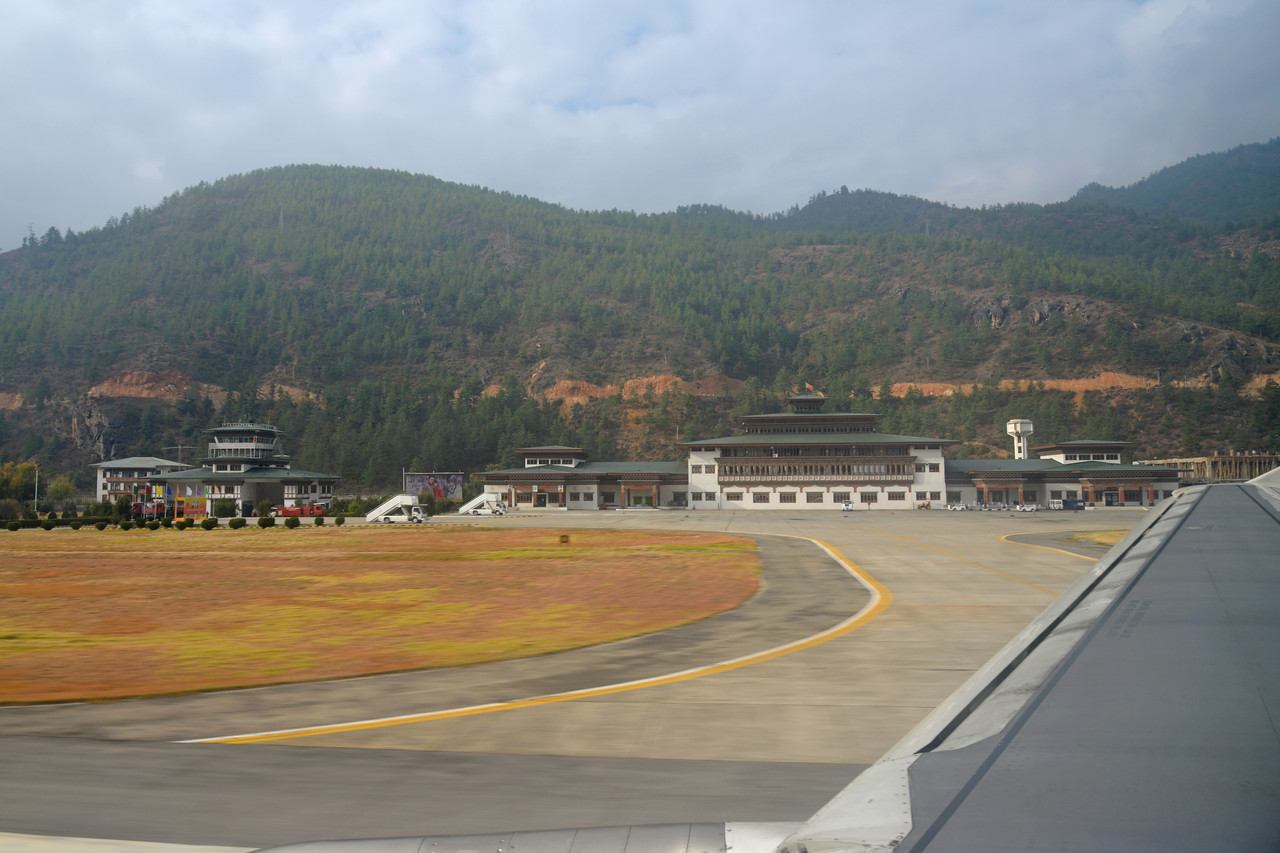 Paro International Airport, Bhutan. India helped build the Paro Airport <br /> and now the Government of India (GoI) has committed Nu 680M, in principle, for the expansion of Paro international airport in the 11th five-year plan (FYP).<br /> <br /> In 1968, the Indian Border Roads Organisation built an airstrip in the Paro valley, which was initially utilised for on call helicopter operations by the Indian Armed Forces for the Royal Government of Bhutan. After consideration by King Jigme Singye Wangchuck and the Tshogdu, Drukair was established by Royal Charter on 5 April 1981, ten years after the Druk Gyalpo, King Jigme Dorji Wangchuck gradually began to open up the Kingdom from self-imposed isolation, and seven years after welcoming its first foreign visitors.