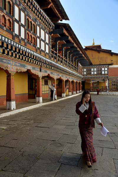 Officials inside Paro Rinpung Dzong. Rinpung Dzong is a large dzong - Buddhist monastery and fortress - of the Drukpa Lineage of the Kagyu school in Paro District in Bhutan. It houses the district Monastic Body and government administrative offices of Paro Dzongkhag