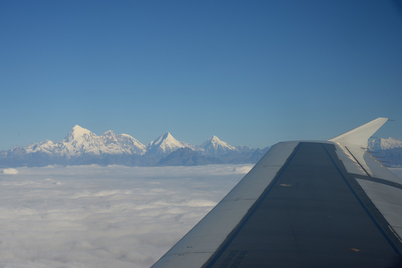 View of the Himalayan range including the peaks of Mount Everest enroute flight from Paro, Bhutan to Mumbai, India on Druk Air flight.