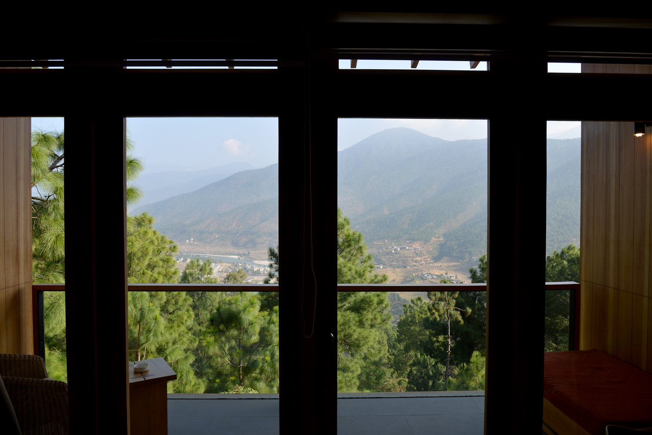 View from our room. Dhensa Boutique Resorts opened its first resort in Bhutan's Punakha Valley in March 2014. Dhensa Resort is a boutique property, located in the heart of Bhutan's verdant and lush Punakha Valley. Flanked by thick pine forests, it overlooks the Punakha River and is surrounded by several walking and trekking trails.