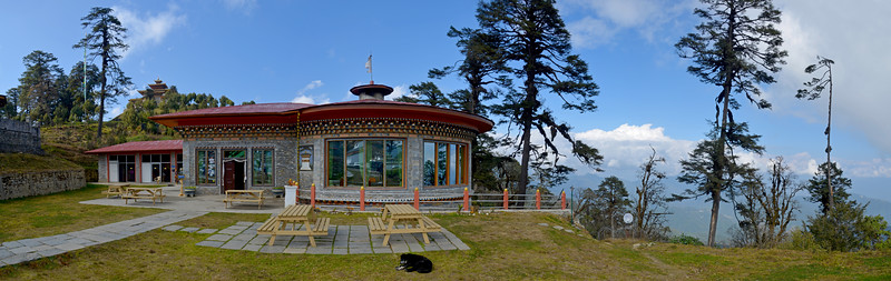 Panoramic image of Dochula Resort Restaurant at Dochu La pass. <br /> Dochu La pass with its fluttering prayer flags and views over the majestic Himalayas, takes your breath away on a clear day. The highly ornate Drukwangyal Lhakhang (temple) and the 108 chortens, was built by the Queen Mother Ashi Dorji Wangmo Wangchuck  to honour the Bhutanese soldiers who were killed when fighting Indian naxals/rebels in 2003.