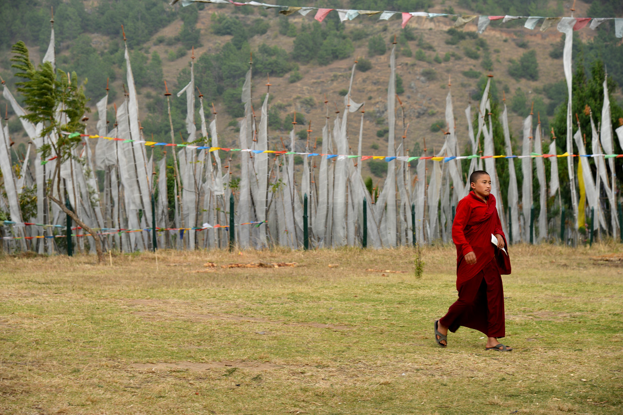 "Monks at the Temple of Fertility (Chimi L'hakhang Temple), Punakha, Bhutan. The site was blessed by the ""Divine Madman"" the maverick saint Drukpa Kunley (1455–1529) who built a chorten on the site."
