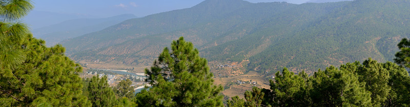 Panoramic view of at Punakha, Bhutan from the balcony (sit out area) of our room in Hotel Dhensa.<br /> Dhensa Boutique Resorts opened its first resort in Bhutan's Punakha Valley in March 2014. Dhensa Resort is a boutique property, located in the heart of Bhutan's verdant and lush Punakha Valley. Flanked by thick pine forests, it overlooks the Punakha River and is surrounded by several walking and trekking trails.