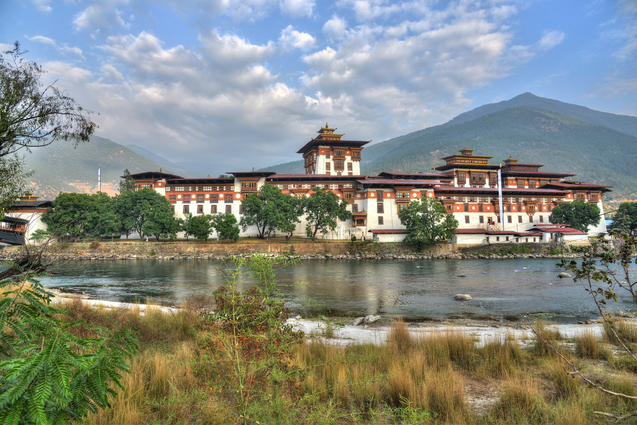 "The Punakha Dzong, also known as Pungtang Dechen Photrang Dzong (which means ""the palace of great happiness or bliss""), is the administrative centre of Punakha District in Punakha, Bhutan."