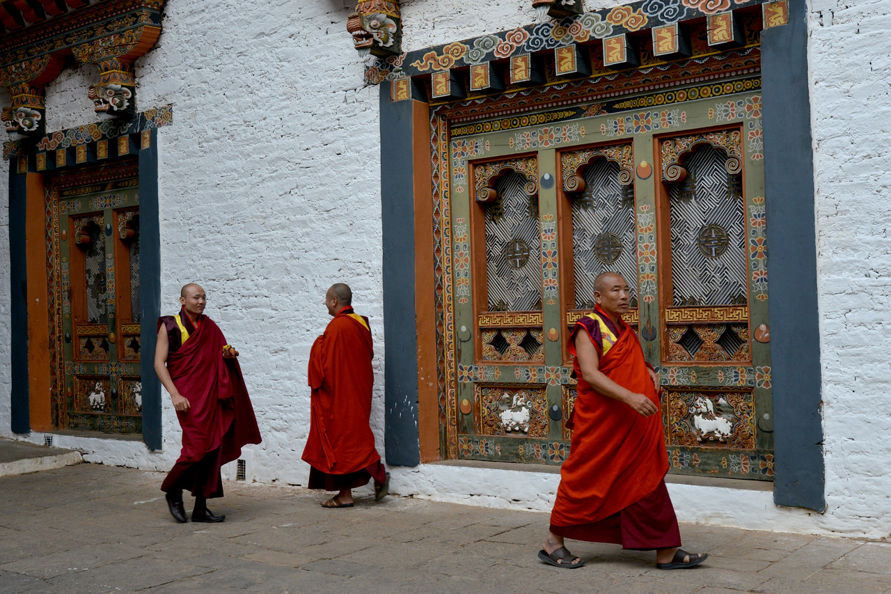 """Monks at The Punakha Dzong, also known as Pungtang Dechen Photrang Dzong (which means """"the palace of great happiness or bliss""""), is the administrative centre of Punakha District in Punakha, Bhutan."""