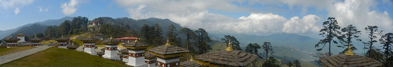Panoramic image at Dochu La pass. <br /> Dochula pass is located on the way to Punakha from Thimphu. With its fluttering prayer flags and views over the majestic Himalayas, takes your breath away on a clear day. The highly ornate Drukwangyal Lhakhang (temple) and the 108 chortens, was built by the Queen Mother Ashi Dorji Wangmo Wangchuck  to honour the Bhutanese soldiers who were killed when fighting Indian naxals/rebels in 2003. Walking around the 108 Chortens at the pass is a surreal experience and due to its significance the visitors are very respectful of the spiritual nature of this place.