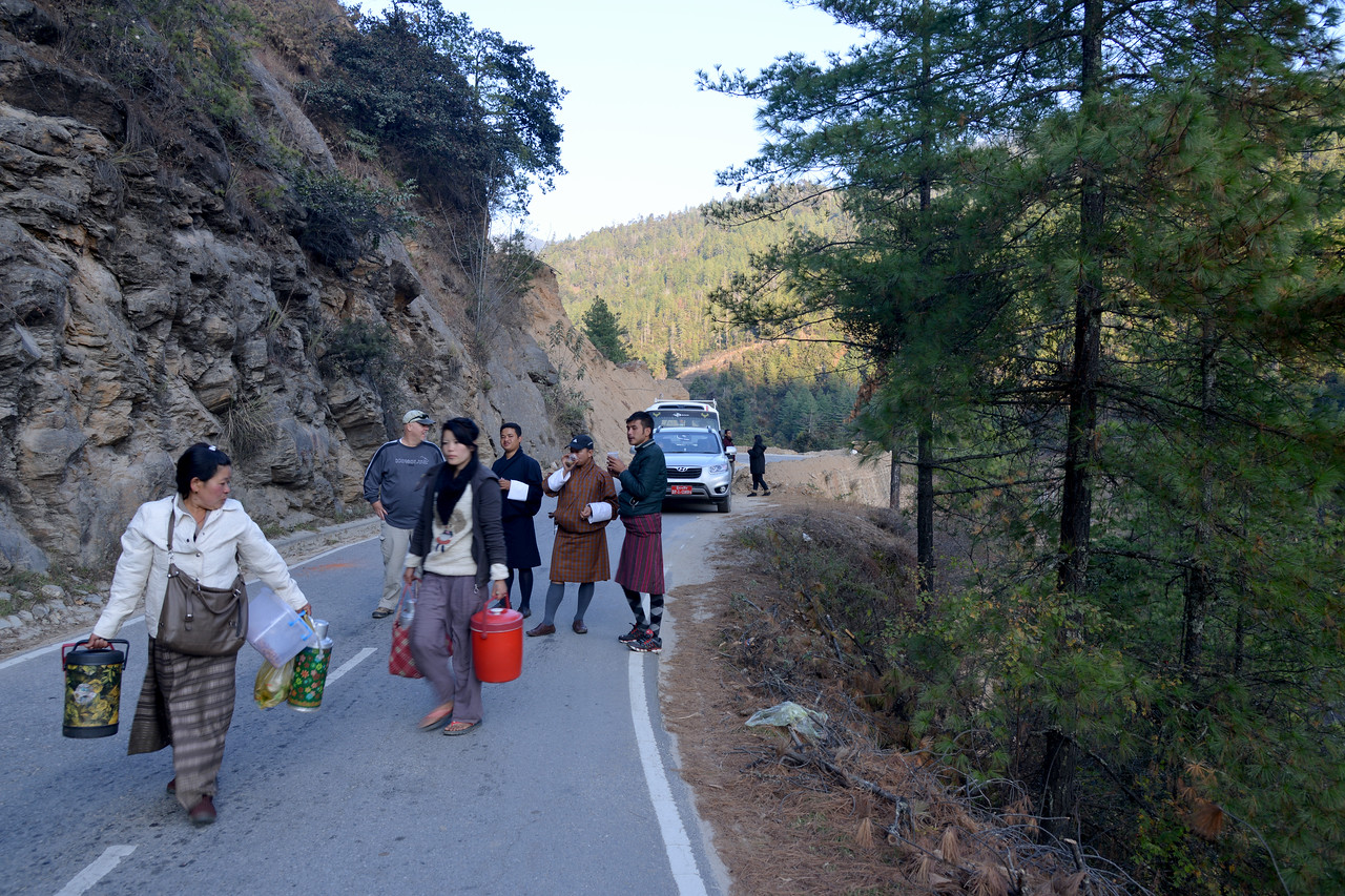 Enroute Punakha to Paro, Bhutan there were road blocks so locals selling food and drinks on the streets.