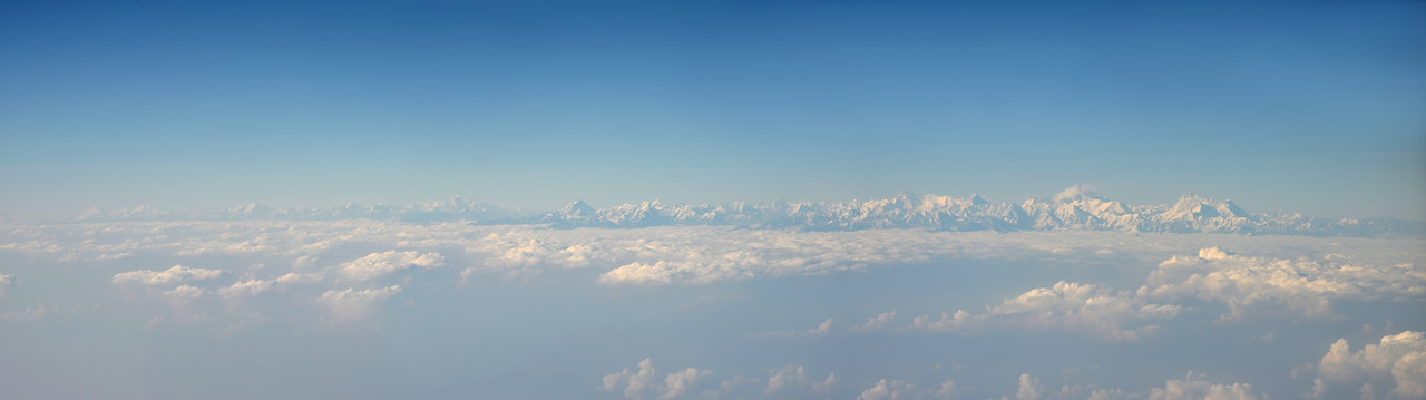 Panoramic view of the Himalayan range enroute flight from Mumbai, India to Paro, Bhutan on Druk Air flight.