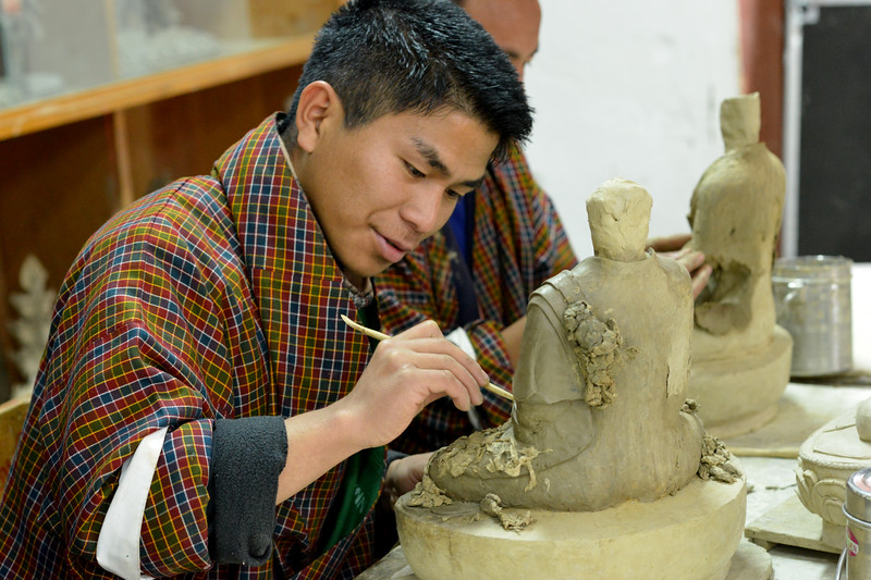 Students learning hand skills at the National Institute for Zorig Chusum, Dept of Human Resources, Thimphu, Bhutan.<br /> <br /> Commonly known as 'the painting school', four to six-year courses provide instruction in Bhutan's 13 traditional arts and students specialise in painting (furniture, thangka – painted religious pictures, usually on canvas), woodcarving (masks, statues, bowls), embroidery (hangings, boots, clothes) or statue-making (clay).
