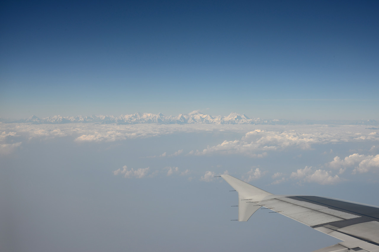View of the Himalayan range including Mt Everest enroute flight from Mumbai, India to Paro, Bhutan on Druk Air flight.