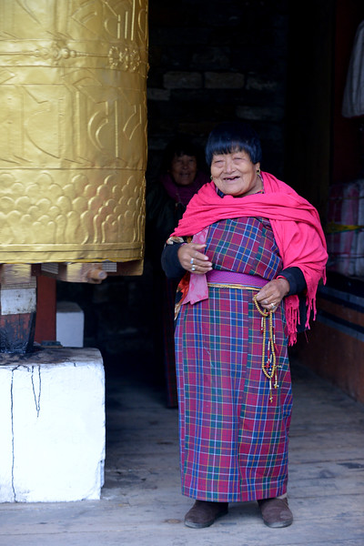 Old lady devotee offering her prayers at the Memorial Chorten, Chhoten Lam, Thimphu, Bhutan.