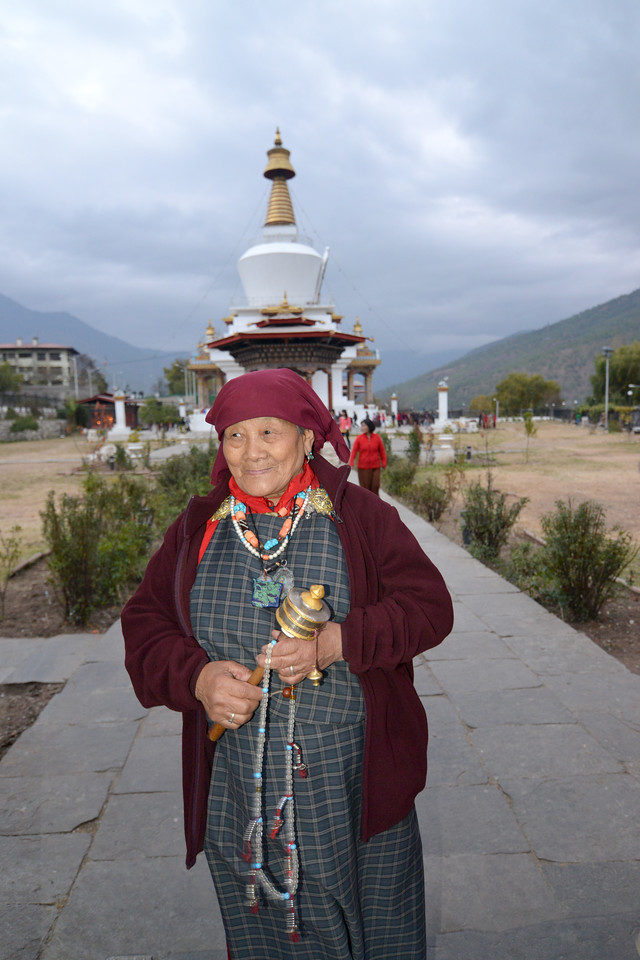 Lady offering prayers and leaving from the Memorial Chorten, Chhoten Lam, Thimphu, Bhutan.