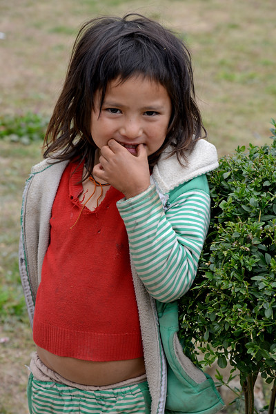 Little girl near the National Library and Archives of Bhutan in Thimphu, Bhutan.