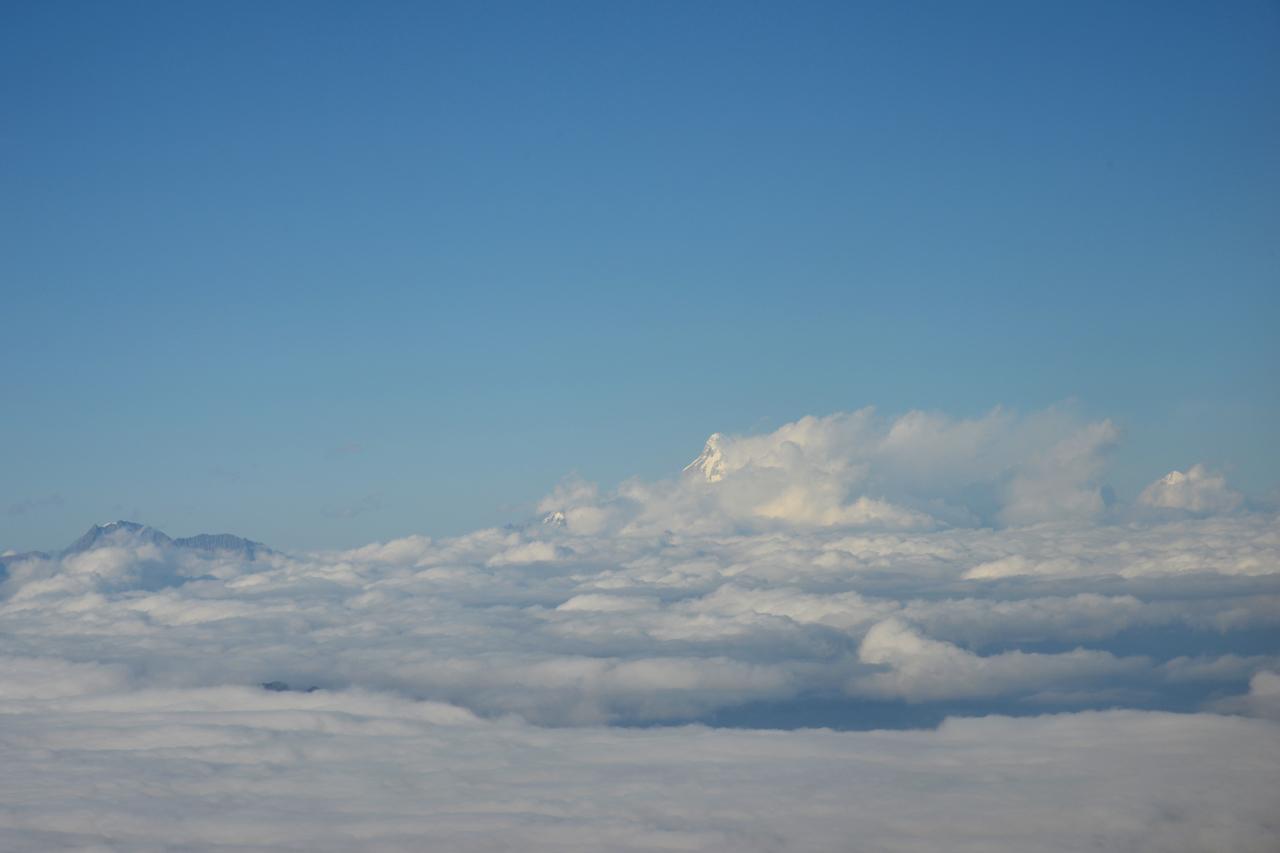 View of the Himalayan range including Mt Everest enroute flight from Mumbai, India to Paro, Bhutan on Druk Air flight.