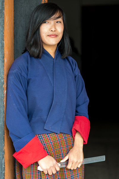 Young student at the National Institute for Zorig Chusum, Dept of Human Resources, Thimphu, Bhutan.<br /> <br /> Commonly known as 'the painting school', four to six-year courses provide instruction in Bhutan's 13 traditional arts and students specialise in painting (furniture, thangka – painted religious pictures, usually on canvas), woodcarving (masks, statues, bowls), embroidery (hangings, boots, clothes) or statue-making (clay).