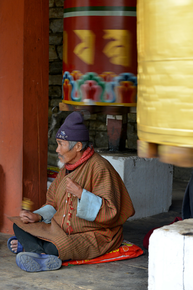People of all ages but particularly the old come and pray at the Memorial Chorten, Chhoten Lam, Thimphu, Bhutan.