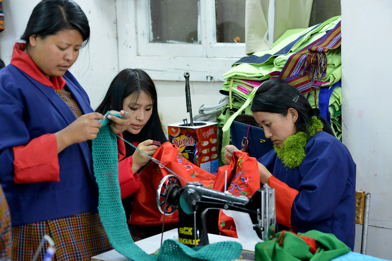 Students learning tailoring at the National Institute for Zorig Chusum, Dept of Human Resources, Thimphu, Bhutan.<br /> <br /> Commonly known as 'the painting school', four to six-year courses provide instruction in Bhutan's 13 traditional arts and students specialise in painting (furniture, thangka – painted religious pictures, usually on canvas), woodcarving (masks, statues, bowls), embroidery (hangings, boots, clothes) or statue-making (clay).