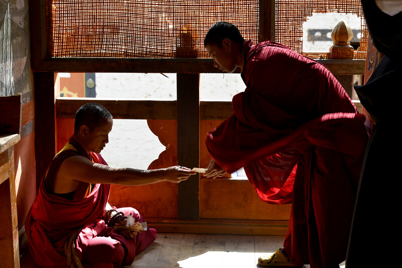 Monks at the Semtokha Dzong, Semtokha, Thimphu, Bhutan.<br /> <br /> Simtokha Dzong is a small dzong located about 3 miles south of the Bhutanese capital of Thimphu. Built in 1629 by Ngawang Namgyal, who unified Bhutan, the dzong is the first of its kind built in Bhutan and was recently renovated. It used to house Dzongkha language learning institutes.