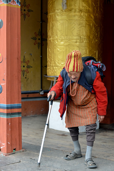 Old devotee offering prayers at the Memorial Chorten, Chhoten Lam, Thimphu, Bhutan.